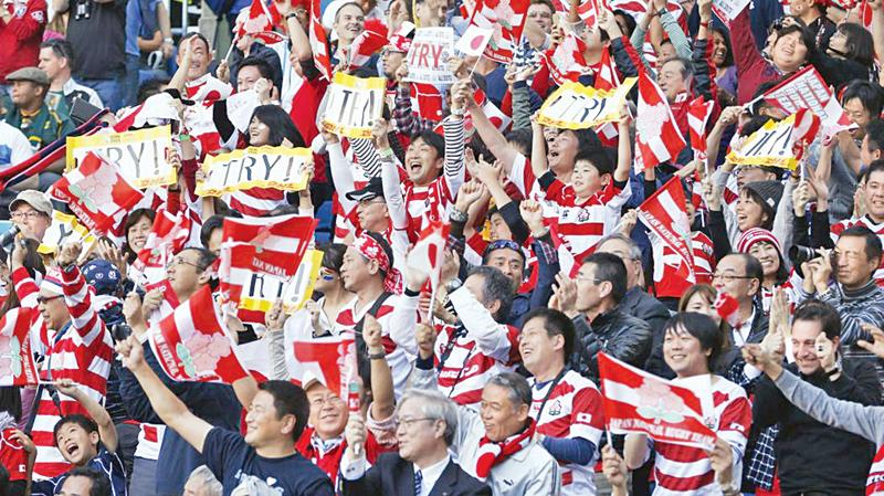 Japanese rugby fans at the World Cup cheer their team