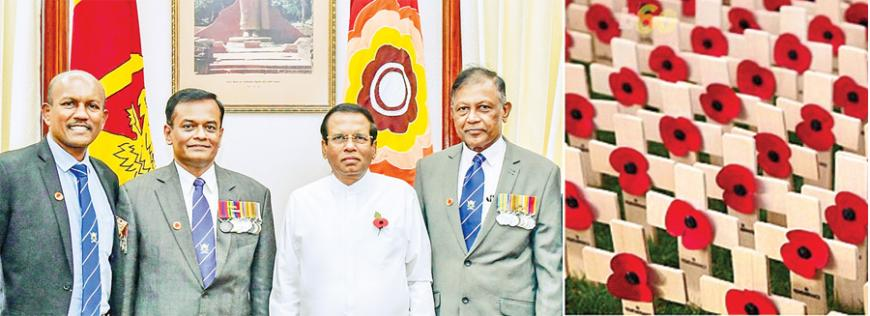 The traditional pinning of the First Poppy on the Commander-in-Chief took place at the Presidential Secretariat. Here, President Maithripala Sirisena is flanked by the President of SLESA, Major General Upul Perera, Chairman of the Armed Forces Remembrance Day, Poppy Commemoration and Cenotaph Development Committee, Rear Admiral Dr. Shemal Fernando and the Secretary General of SLESA, Lieutenant Colonel Ajith Siyambalapitiya.