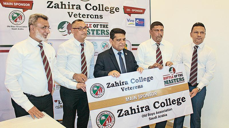 Mohamed Jiffry member of the Executive Committee of the main sponsor of the tournament Old Boys' Association of Zahira College (Saudi Arabia Branch) presents the sponsorship cheque to the Principal of Zahira College Trizviiy Marikkar. President of the Zahira Veterans T.J. Chuncheer, Zahira College OBA President Naina Mohamed and Project Chairman Shaffie Namiz were also present
