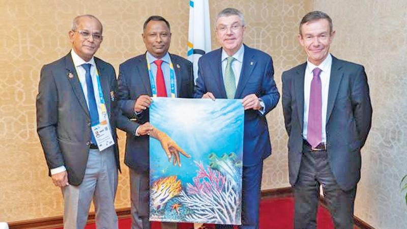 President of the National Olympic Committee of Sri Lanka Suresh Subramaniam and its General Secretary Maxwell de Silva with the International Olympic Committee Chairman Dr. Thomas Bach