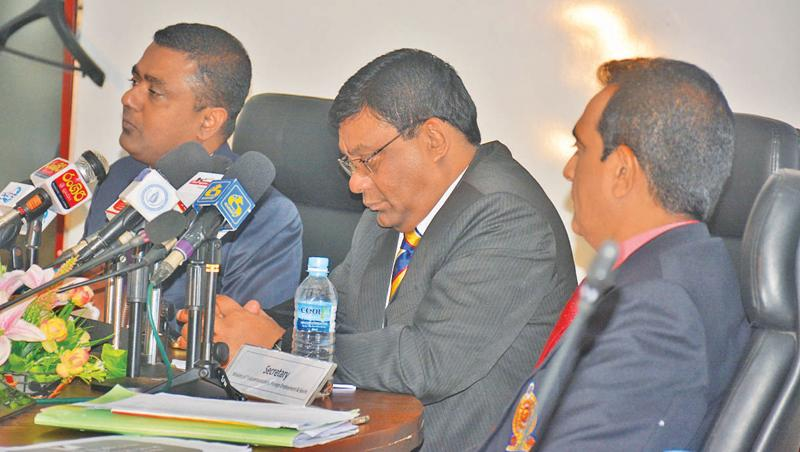 Secretary to the Ministry of Sports Chulananda Perera (centre) addressing the Media on arrangements for the 45th National Sports Festival to be held in Badulla from October 24-27. Also in the picture are Director General Sports Ministry Dhammika Muthugala (left) and Director Sports IP Wijeratne (Picture by Ranjith Asanka)