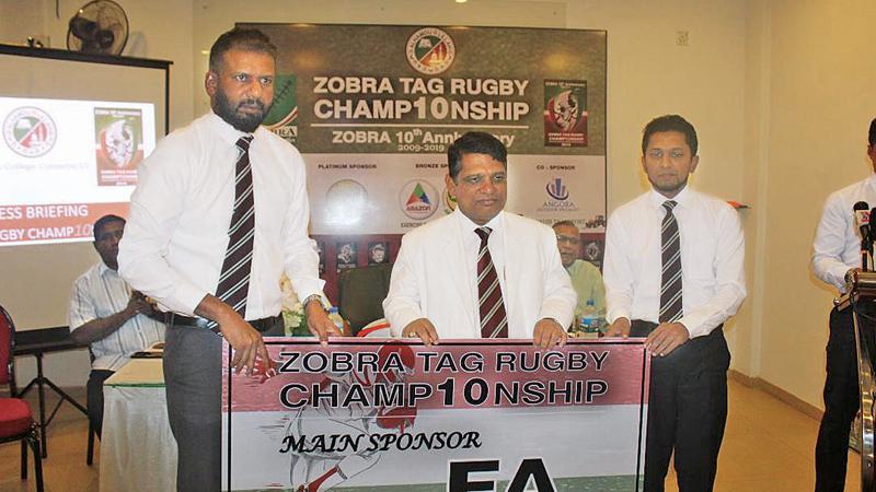 Nazeem Ghaffoor presents the main sponsorship on ehalf of Fawzan Anver to the principal of Zahira College Trizviiy Marikkar as president of the ZOBRA Hussain Wasique is looks on