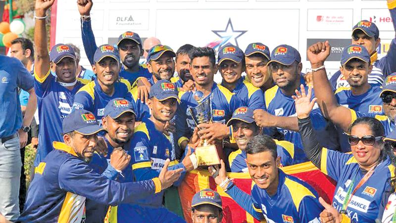 File photo of Sri Lanka's hearing impaired cricketers celebrating winning the inaugural ICC Deaf T20 World Cup last year