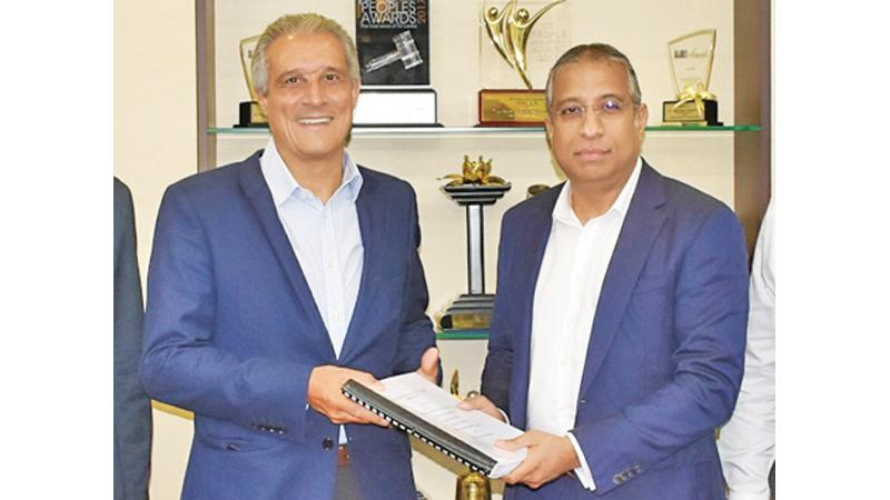 Chief Executive Officer of Barceló Hotel Group, Raúl González exchanges the MoU with Deputy Chairman, LOLC Group and Chairman, Browns Group, Ishara Nanayakkara.
