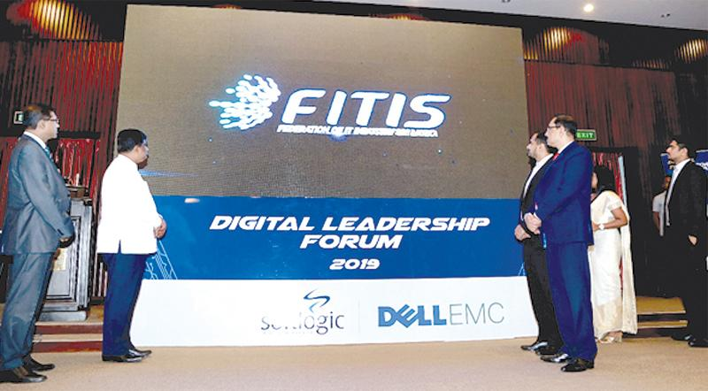 Minister of Digital Infrastructure and Information Technology, Ajith P. Perera unveils the new brand identity. Chairman, FITIS, Abbas Kamrudeen, CEO, FITIS, Aruna Alwis look on.