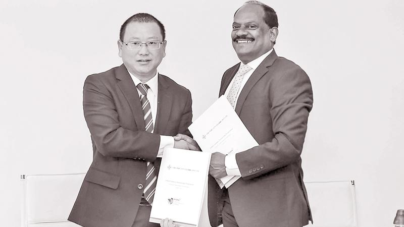 CHEC Port City Colombo (Pvt) Ltd Managing Director Jiang Houliang exchanges the MoU with NSBM Green University Town Vice Chancellor Prof. E. A. Weerasinghe