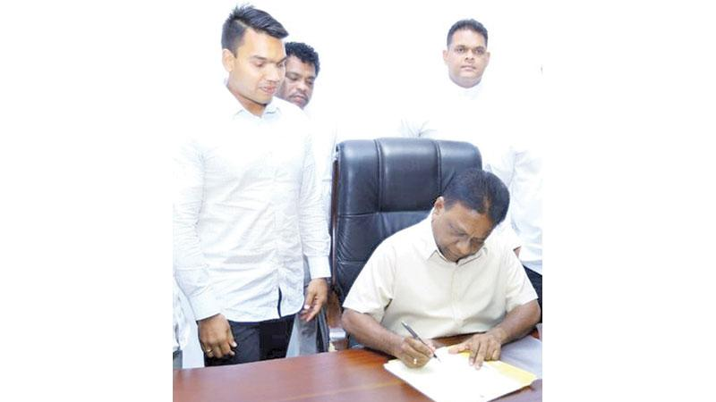 Newly appointed Sports Minister Dallas Alahapperuma assumes duties as former Sri Lanka rugby captain and MP Namal Rajapaksa (left) and MP Shehan Semasinghe (right) grace the occasion
