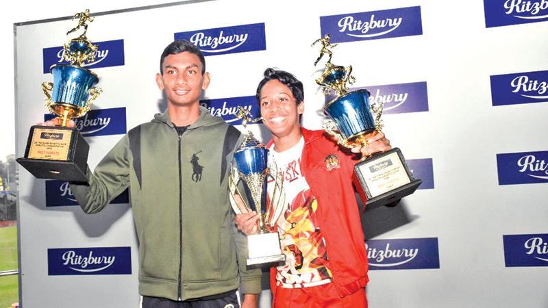 Best athletes M Kaushan (left-De Mazenod College) and Seneka Gunaratne (CIS Kandy)