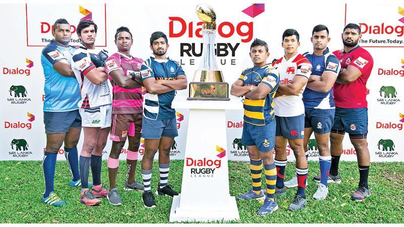 The captains of Air Force (Ranuka Medagedera), CH and FC (Rohitha Rajapaksa), Havelocks (Mithun Hapugoda), Navy (Richard Dharmapala), Army (Manoj Bandara), Kandy SC (Nigel Ratwatte), Police (Chanaka Harischandra) and CR and FC (Omalka Gunaratne) pose with the Dialog trophy