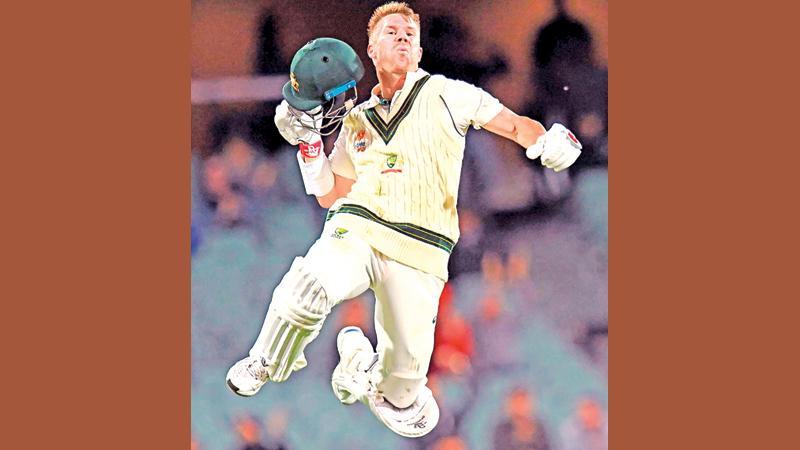 David Warner celebrates his epic innings (AFP)