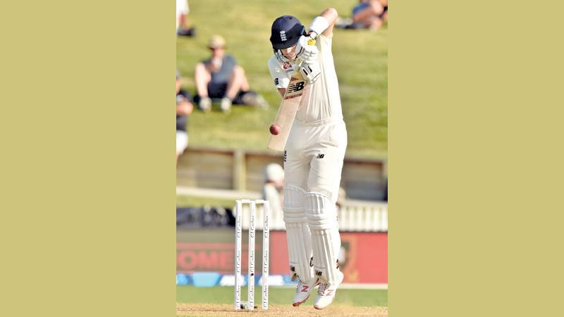 England's captain Joe Root plays a shot (AFP)