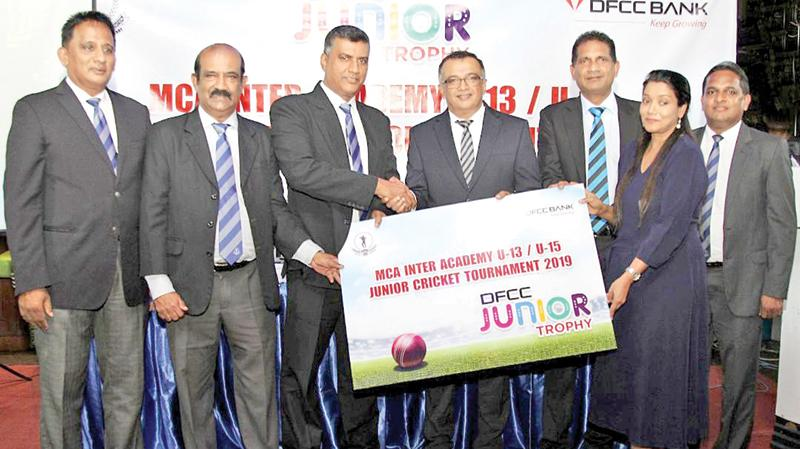 DFCC Bank Chief Operating Officer and Senior Vice President Achintha Hewanayake, Vice President Liabilities and Trade Business Development, Anton Arumugam and Vice President Marketing Nilmini Gunaratne handing over the sponsorship package to the MCA represented by Rohana Dissanayake, President