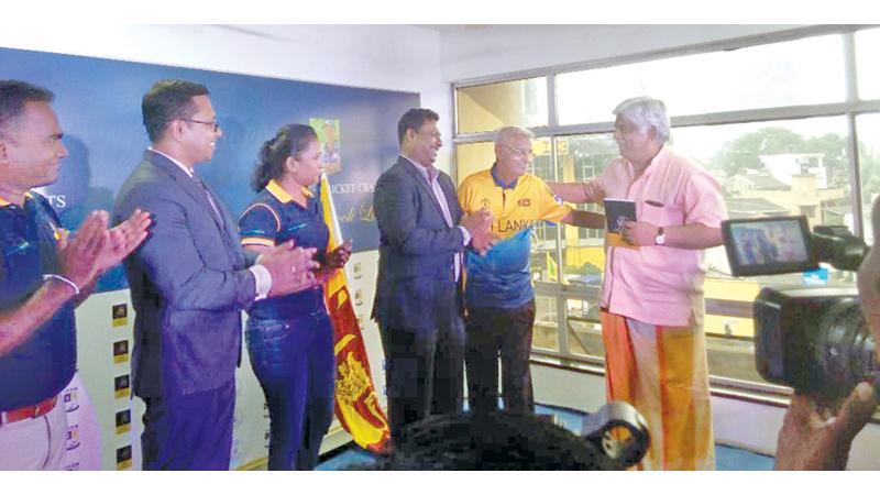 Percy Abeysekera presents his book to Arjuna Ranatunga in the presence of Chance Sports chairman Lasantha Amarasinghe