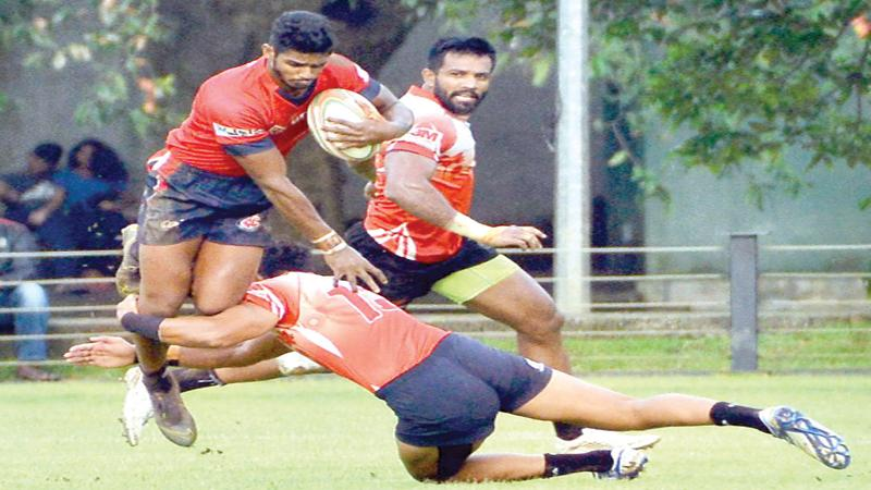 CR's forward Janidu Fernando is airborne in the face of a tackle from the CH defence in their Dialog League rugby match at the Race Course ground in Colombo yesterday (Pic Saman Mendis)
