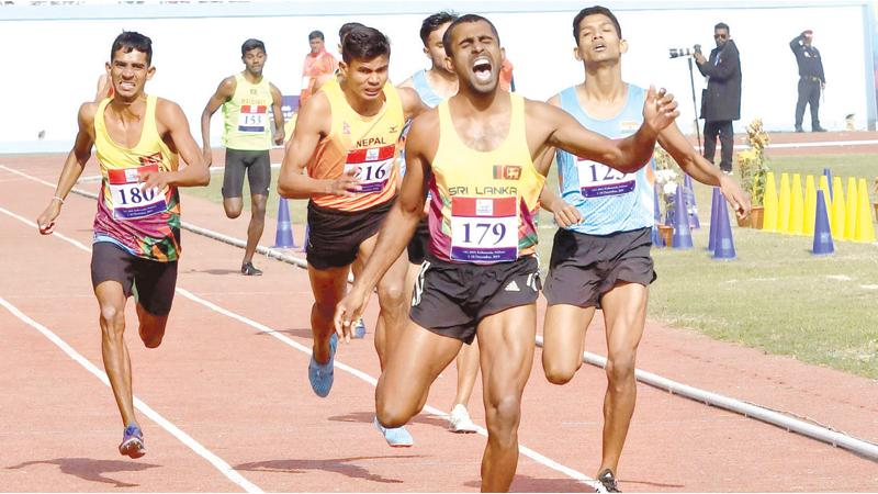 Sri Lanka's Indunil Herath wins the Gold medal in the 800 metres at the South Asian Games in Katmandu, Nepal yesterday (AFP)