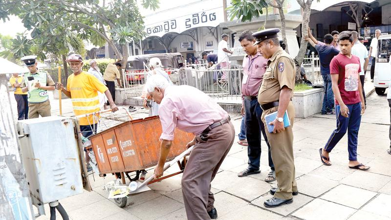 A clean up in progress under the watchful eye of the Police