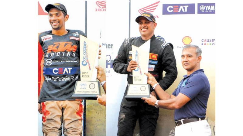 Champion rider at the Colombo Supercross 2019 at the Welisara naval track Jacques Gunawardena (left) and winning driver Ashan Silva receive their coveted trophies from Chief of Staff of the Navy Nishantha Udagedera (Pix by Saman Sri Wedage)