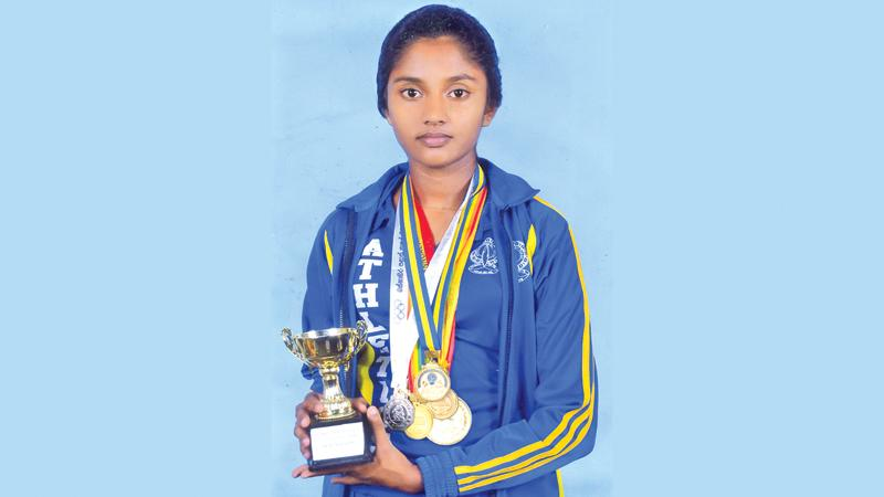 Ranindi Gamage with her trophy and medals