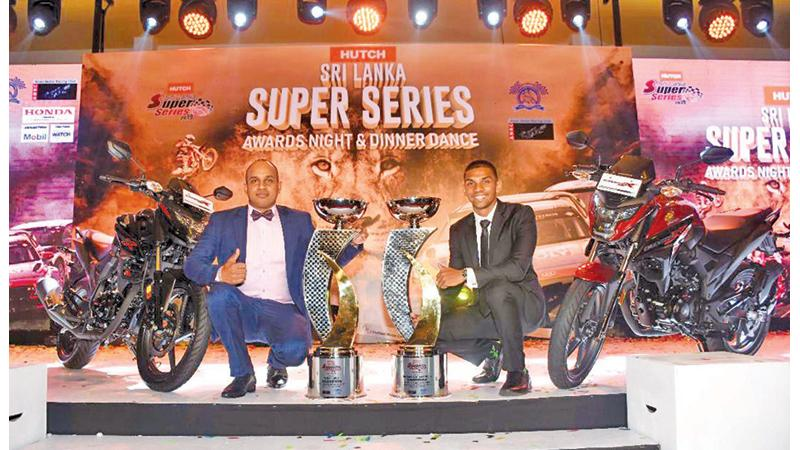 Hutch Super Series winners driver Ashan Silva and rider Jacques Goonawardena pose for a picture after receiving their awards and a Honda 250cc motorcycle each from Stafford Motors