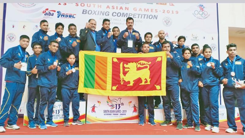 The Sri Lanka boxing squad that competed at the recently concluded 13th South Asian Games in Nepal comprising Sanjeewa Nuean 49 kgs, KVL Eranda  52 kg (Bronze), GNK Amarawansa 56Kgs, Wimukthi Kumara 60 kgs (Bronze), PVDD Saparamadu 64 kgs (Bronze), NM Hettiarachchi 69kgs, PDD Maduranga 75 kgs (Silver), WAR Sandakalum 81 kgs (Gold), ARBE Tillekaratne 91 kgs (Bronze), Nadeeka Pushpakumari 49 kgs (Bronze), KAK Nilmini 51 kgs (Bronze), MPPS Cooray 54 kgs (Bronze), KAD Dharmathilaka  57 kgs (Silver), KAK Hansika