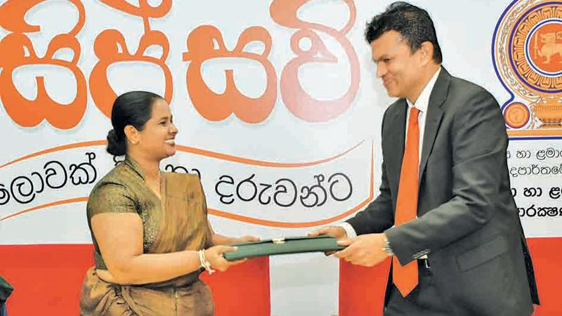 The Commissioner, Department of Probation and Child Care Services, Chandima Sigera and Managing Director, Atlas Axillia, Asitha Samaraweera, exchanging the MoU agreement.