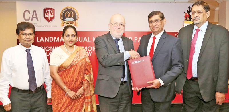 President of CA Sri Lanka Jagath Perera, exchanges the MoU with Executive Director, Learning and Professional Development, ICAEW Mark Protherough. The Institute's Vice President Manil Jayesinghe, CEO Dulani Fernando and Secretary Prasanna Liyanage look on.