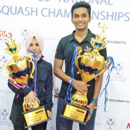 Ravindu Laksiri (right) and Fathoum Issadeen pose with their titles