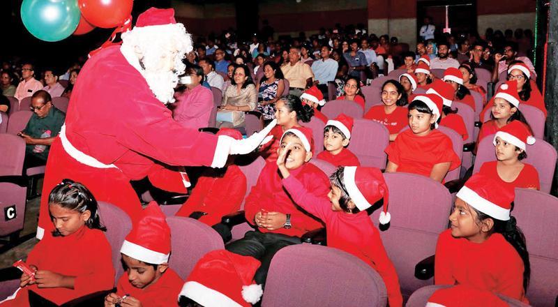 Santa entertains children.