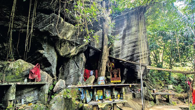 QUAINT CHARM: The Purana Pattini Devale at Koththalena inside the growing rock boulder