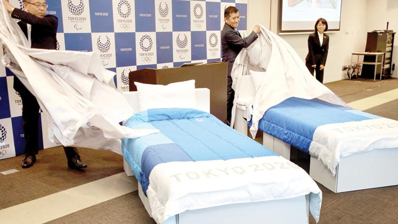 In this picture taken on September 24, 2019  beds made of cardboards for the Tokyo 2020 Olympic and Paralympic Village are displayed in Tokyo. - Randy athletes worried that eco-friendly cardboard beds could curtail their sex life at this summer's Tokyo Olympics can breathe easy -- they're sturdy enough, say manufacturers. (AFP)