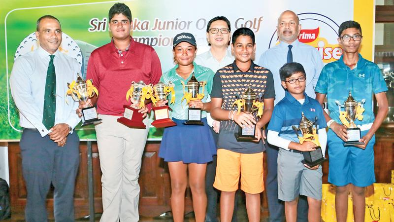 Junior Golf Championship winners with their awards: Gold division boys winner Nirekh Tejwani, Copper division winner Thejas Rathis Kanth, Bronze division winner Reshan Algama, Silver division winner K. Danushan and girls winner Taniya Balasuriya pose for a picture with Captain Royal Colombo Golf Club, Shiran Fernando, President SLG, Rtd. Air Chief Marshall Harsha Abeywickrema and General Manager Ceylon Agro Industries, Shun Tien Shing
