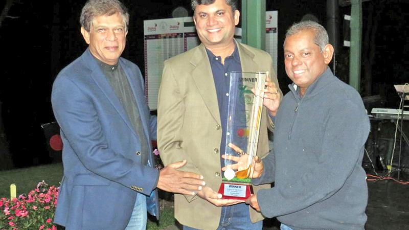 Priyanga Hapugalle the captain of the Invitational Sri Lanka team receiving the NEGC Mastercard Trophy from Santosh Kumar, Country Manager, Mastercard, Sri Lanka & Maldives and Maj Gen Srinath Rajapakse, President NEGC