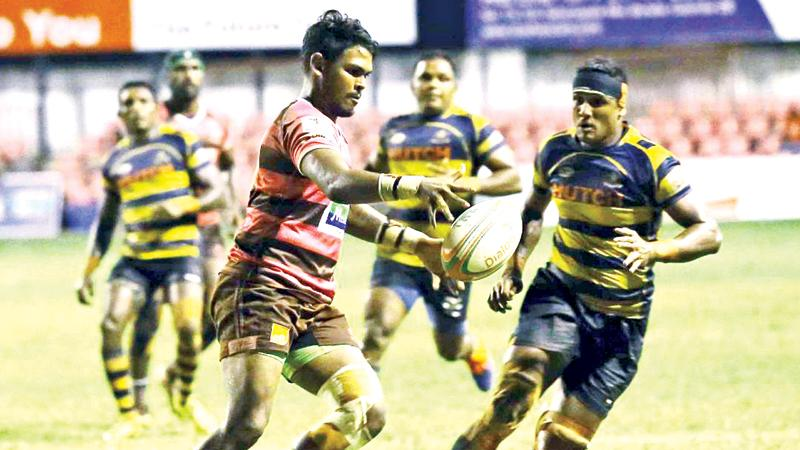 Havelocks fly-half Sandesh Jayawickrema attempts to kick ahead in the face of opposition from Army  (Pic: Chaminda Niroshana)