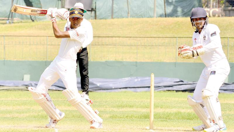 Royal College batsman Isiwara Dissanayake cuts a ball on his way to a century during the second day's play of their inter school match against St. Peter's College at the SSC ground in Colombo yesterday  (Pic by Saman Mendis)