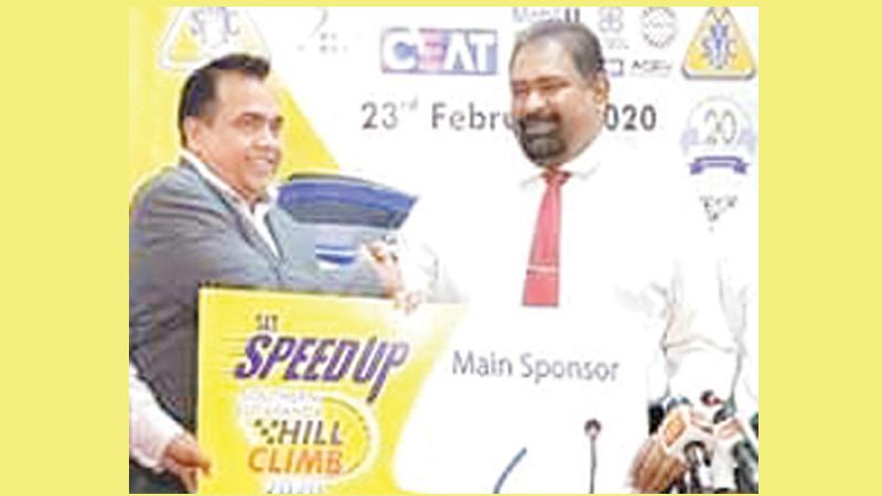 General Manager Sri Lanka Telecom Rohana Ellawala (left) presents the sponsorship to Dr. Sanjaya Sedara Senarath, the President of the SMSC