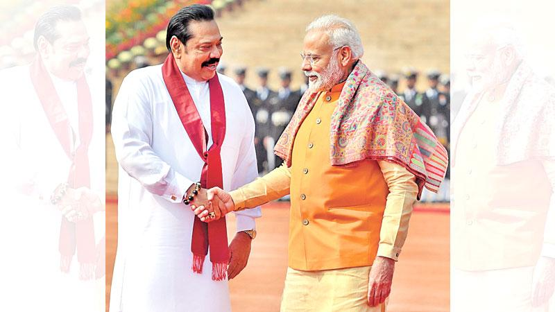 India's Prime Minister Narendra Modi shakes hands with Sri Lanka's Prime Minister Mahinda Rajapaksa during a ceremonial reception at the Presidential palace in New Delhi yesterday. Prime Minister Rajapaksa is due to conclude his four-day state visit to India tomorrow. – AFP