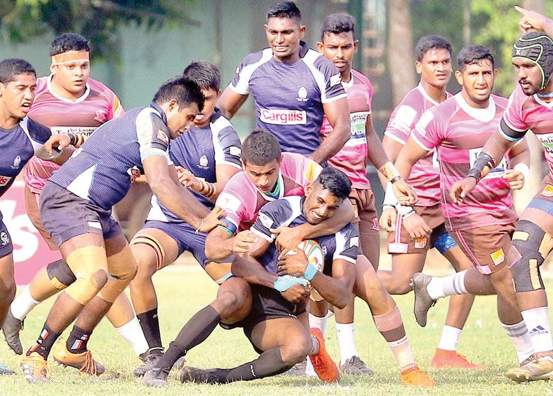 Police winger Sajith Silva is tackled by Havelocks flanker Shenal Deelaka   Pic by Saman Sri Wedage