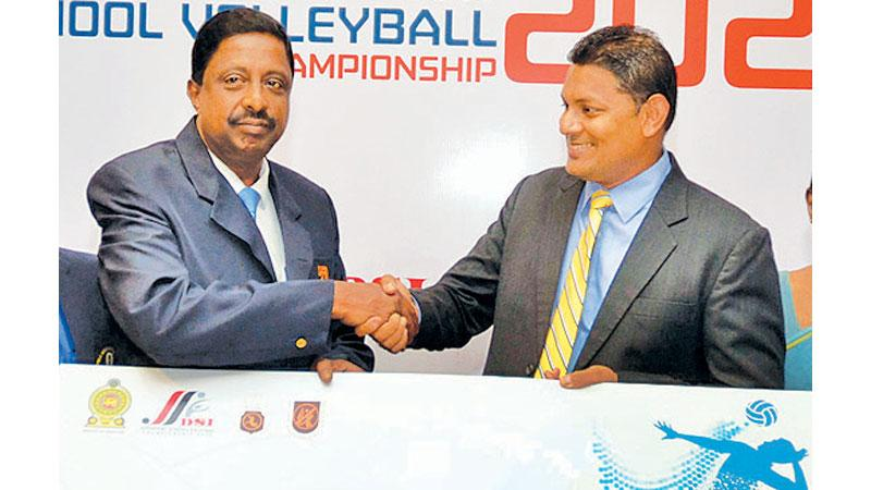Managing Director of D. Samson Sons Thusitha Rajapakse (left) presents the sponsorship for the 20th DSI Schools Super Sport VB Championship to Secreatary General SLVBF AS Nalaka. (Picture by Vipula Amarasinghe)