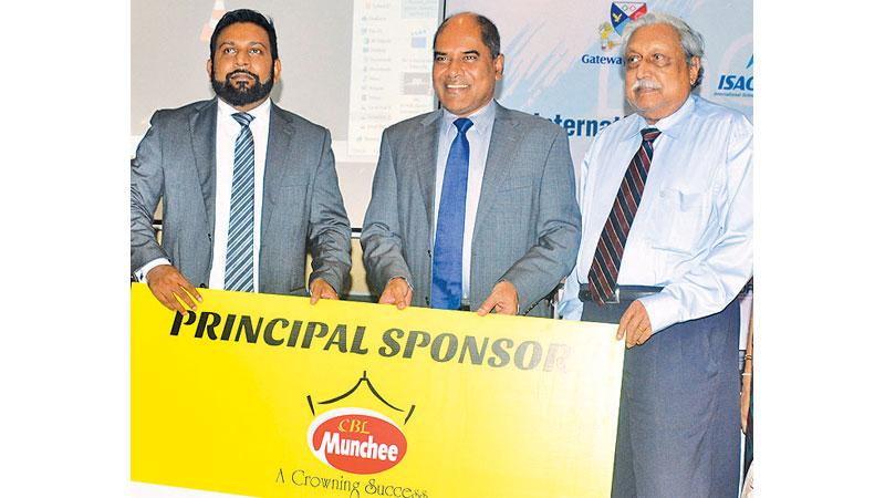 Main sponsor Ceylon Biscuits Managing Director S. Wickramasinghe (left) and principal sponsor Edexcel Territory Manager for Sri Lanka, Maldives, Pakistan and Nepal, Suriya Bibile (right) presenting the sponsorship to Gateway Group Chairman Harsha Alles. Picture by Ranjith Asanka