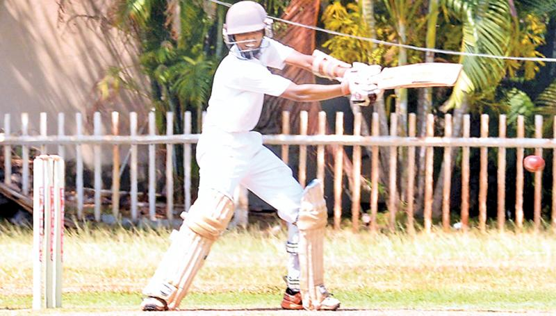 Wesley College batsman Sahir Dias cuts a ball to the fence during his match-saving innings of 51 against Royal College at Campbell Park yesterday Pic: Saman Mendis