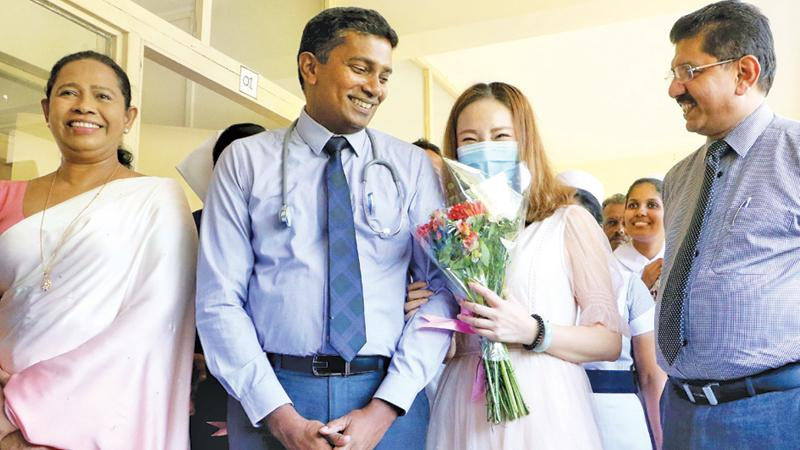 The Chinese national with doctors and Health Minister Pavithra Wanniarachchi.                                                         Pix: Saman Sri Wedage