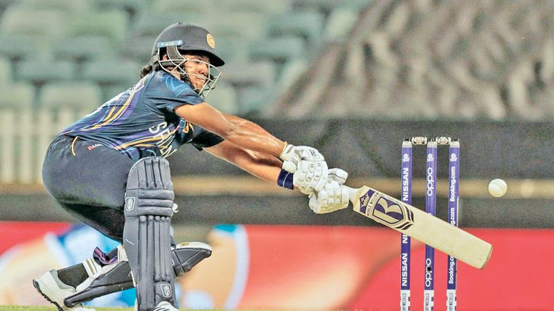 Chamari Atapattu of Sri Lanka plays a shot during the women's Twenty20 World Cup match against New Zealand in Perth yesterday.  (AFP)