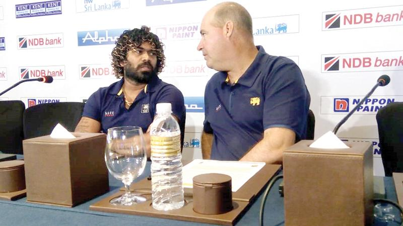 Lasith Malinga  talks to coach Mickey Arthur at the lauch of Sri Lanka  versus West Indies series