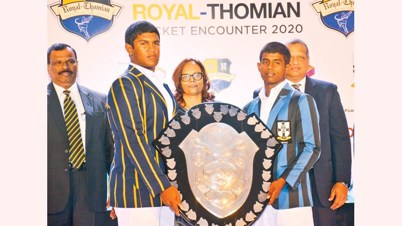 The captains of Royal College, Thevindu Senaratne-left and S. Thomas' College, Thevin Eriyagama pose with the DS Senanayake Shield at the launch of the 141st Battle of the Blues big match at the BMICH on Wednesday in the presence of Royal College Principal B.A. Abeyratne (left), Amali Nanayakkara, Group Chief Marketing Officer, Dialog and Navin Peiris, VP Enterprise Business and Large Enterprise Sales, Dialog  (Pic: Ranjith Asanka)