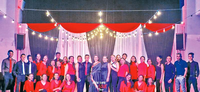 Soundarie David Rodrigo surrounded by her happy choir members
