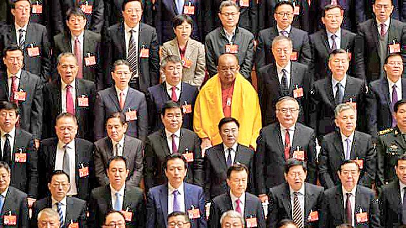 A lone woman is among delegates at the National People's Congress in Beijing. More than 86% of people in China held at least one bias against women in the period 2010 -14. (Pic: Fred Dufour/AFP/Getty Images)