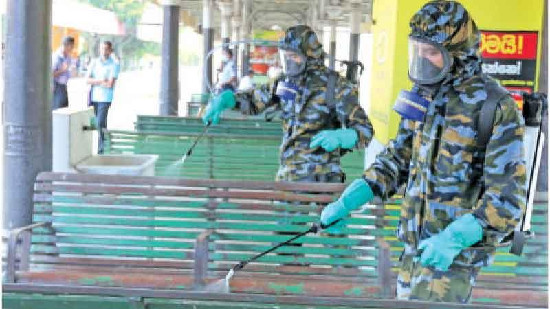 Identify possible work-related exposure and health risks to your employees. Here Security Forces personnel disinfect the Fort Railway Station.  Pic: Nishanka de Silva