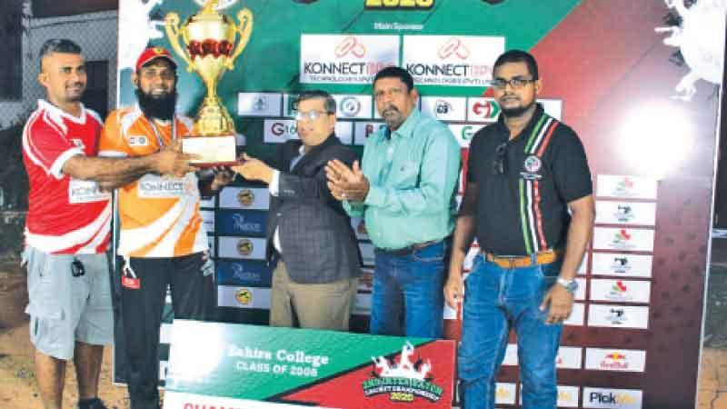 Captain of the G 2003 B Team Mohamed Kaleel receiving the champions trophy from chief guest Alavi Mukthar