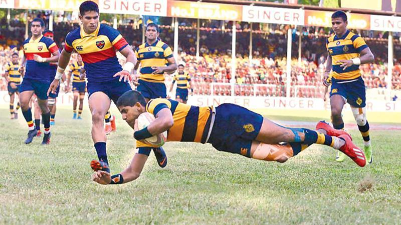 Royal College centre Lehan Gunaratne goes over the line for a try at last year's Bradby match in this file photo captured by Sulochana Gamage