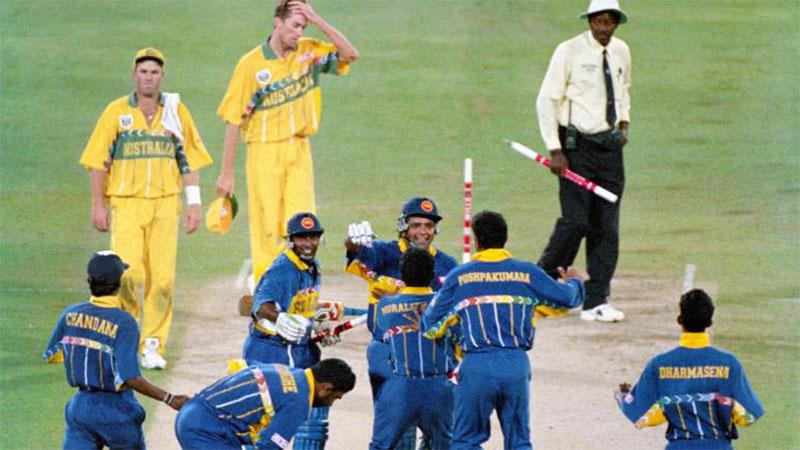 Sri Lanka's cricketers celebrate winning the World Cup by beating Australia